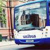 The unibus driving past the museum