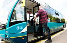 Man getting onto bus