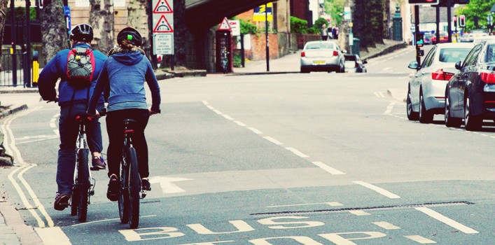 Two cyclists with backpacks on