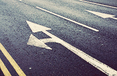 Left and forward filter arrow markings on road