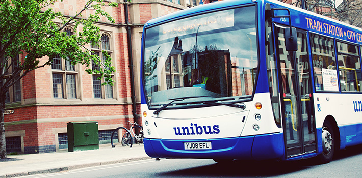 The unibus driving past the museum