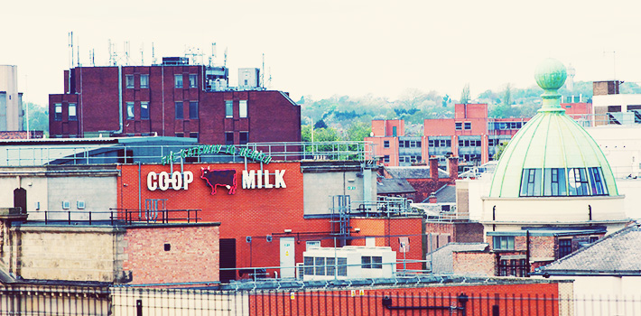 Rooftops of Derby city centre featuring the co-op milk sign and green dome