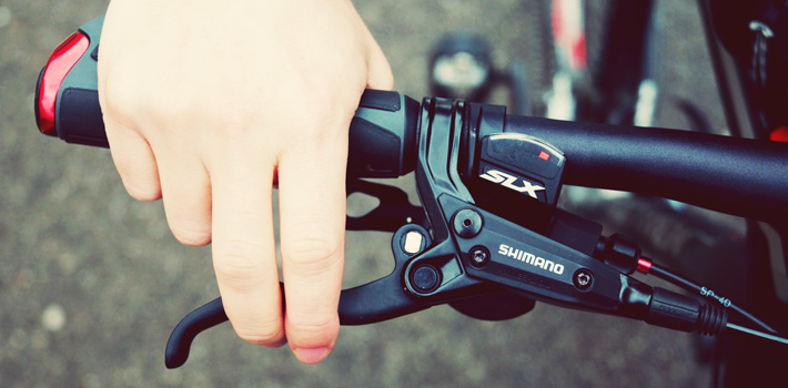 Hands on bike handlebar brakes