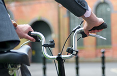 Hands on bicycle handlebars