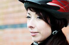 Woman wearing cycling helmet