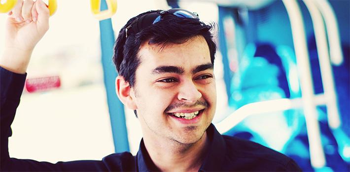 Smiling man on bus