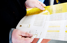 Holding a bus timetable
