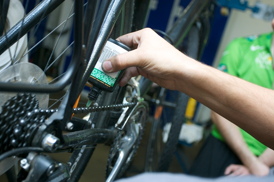 Lubricant being added to bike chain